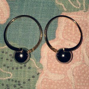 Mixed metal loop earrings with ball accent
